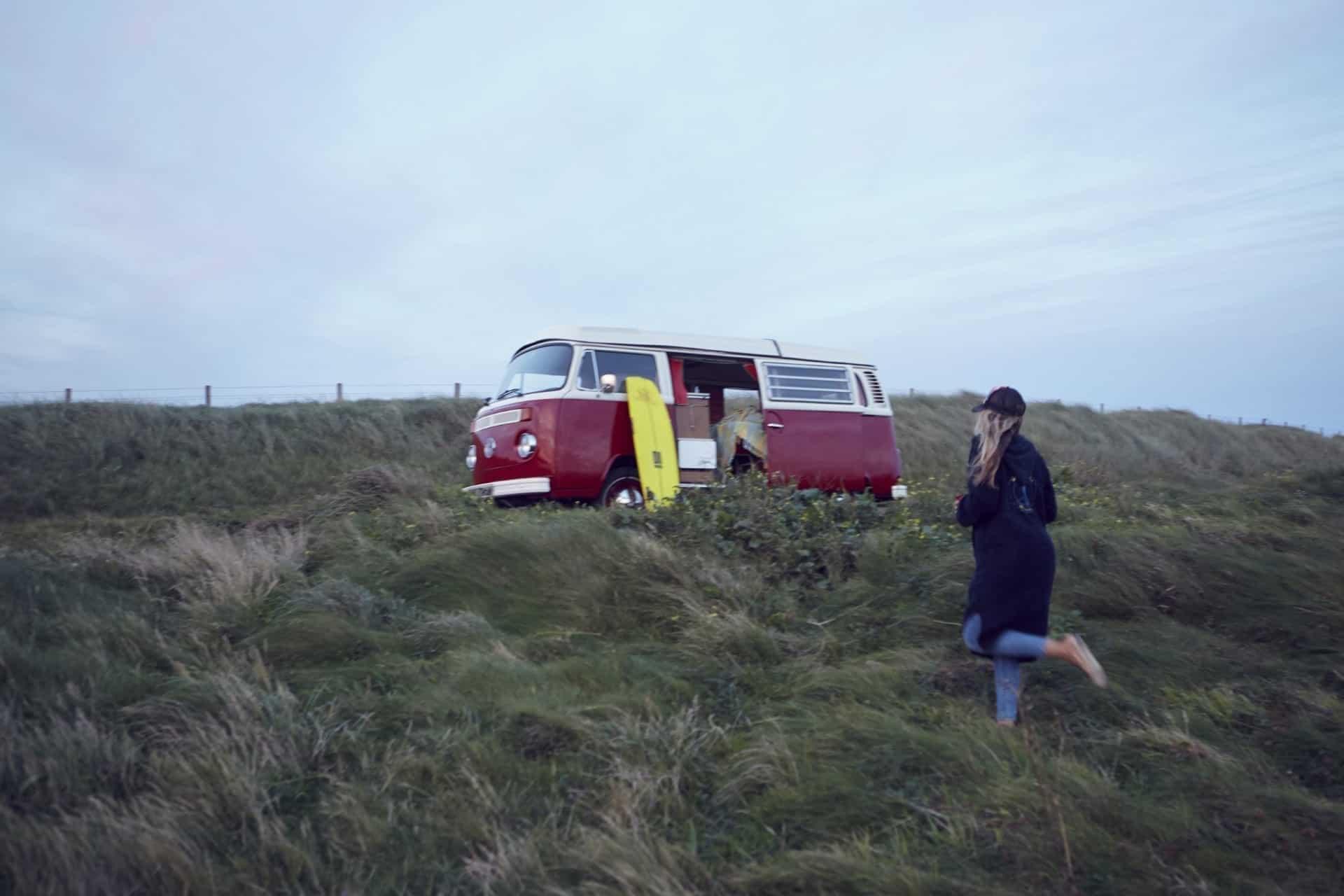 Red campervan near the beach