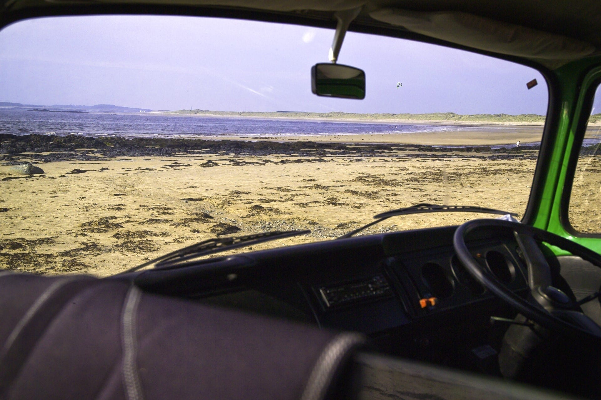 Beach view from a campervan