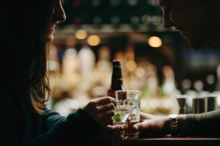 two people drinking at a bar