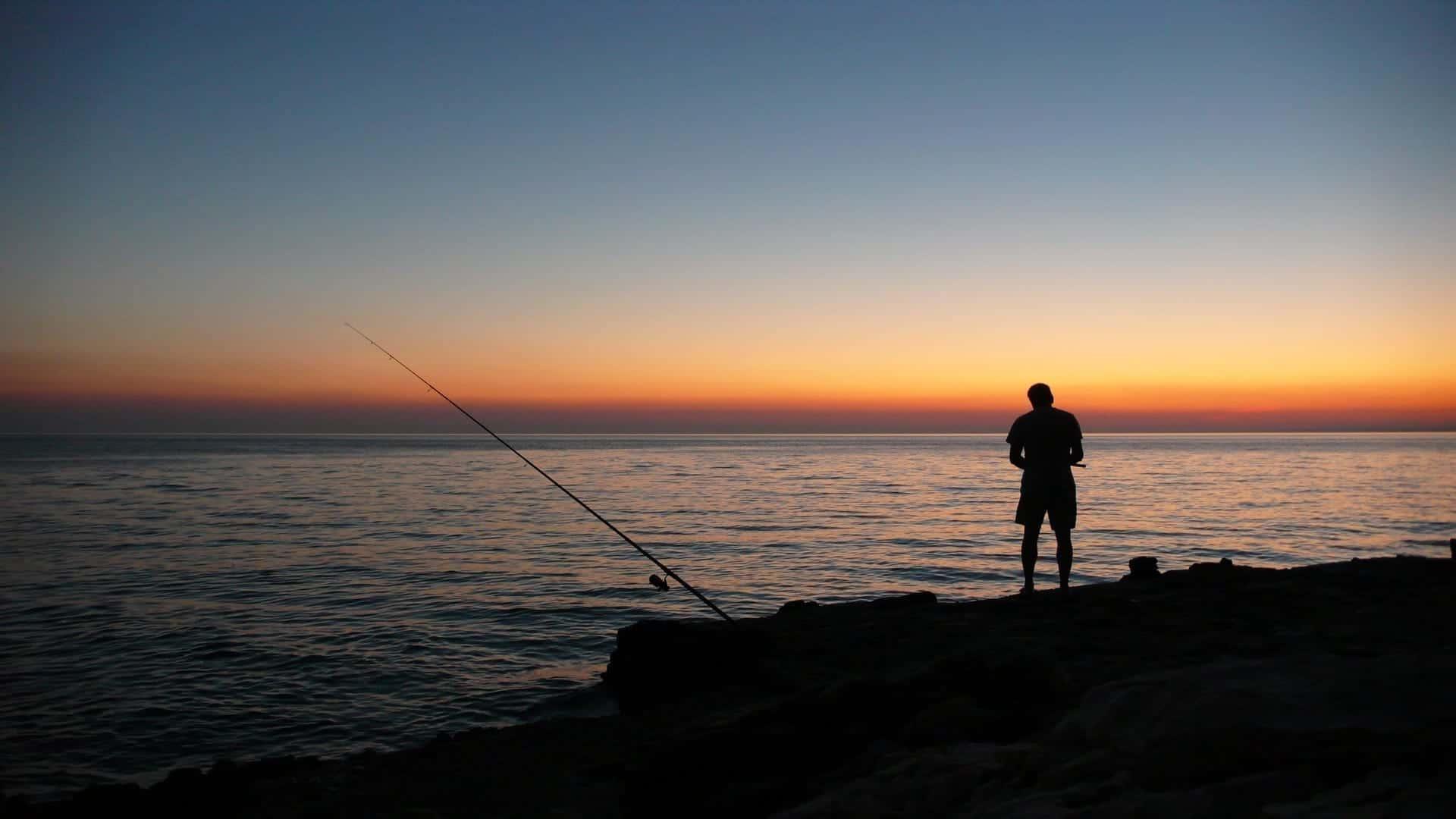 sunset sea angler