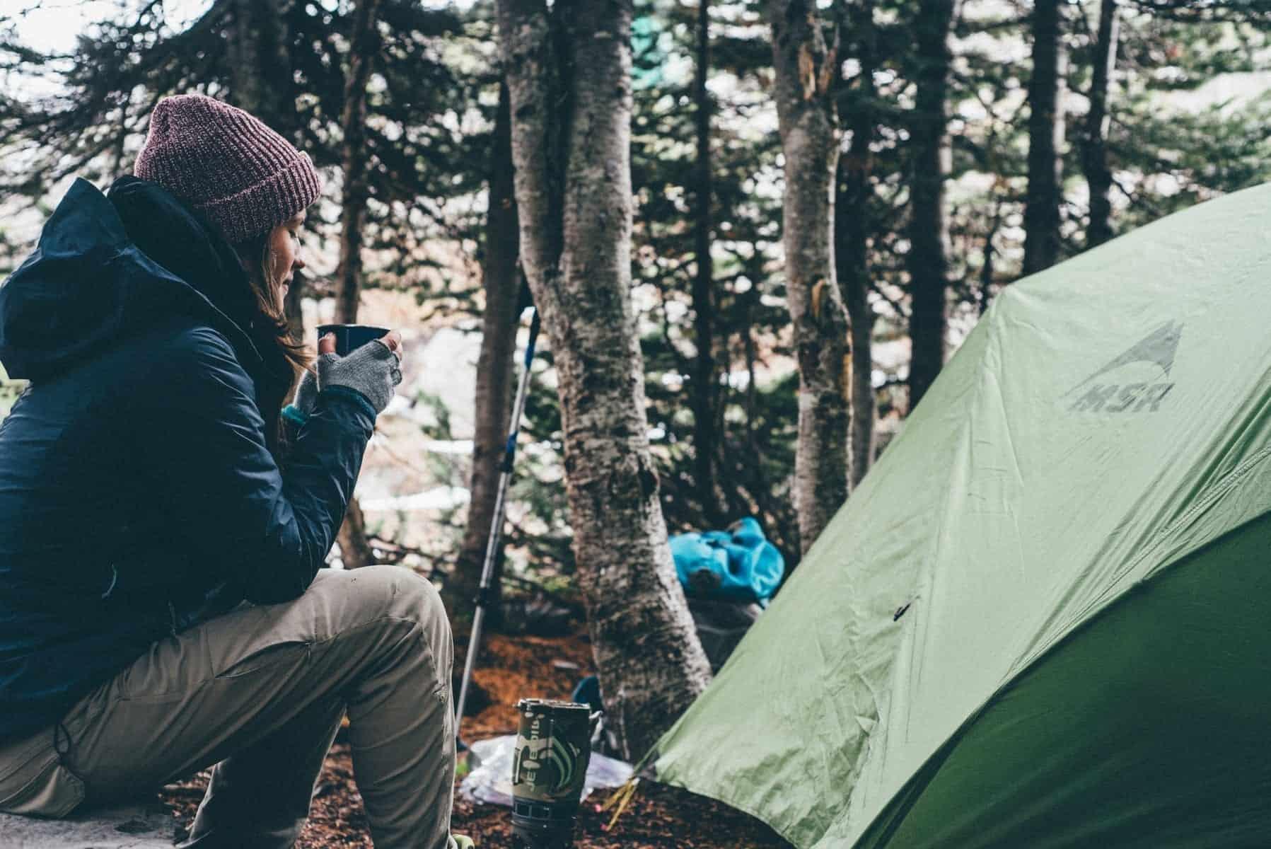 outdoor winter woman adventure camping season