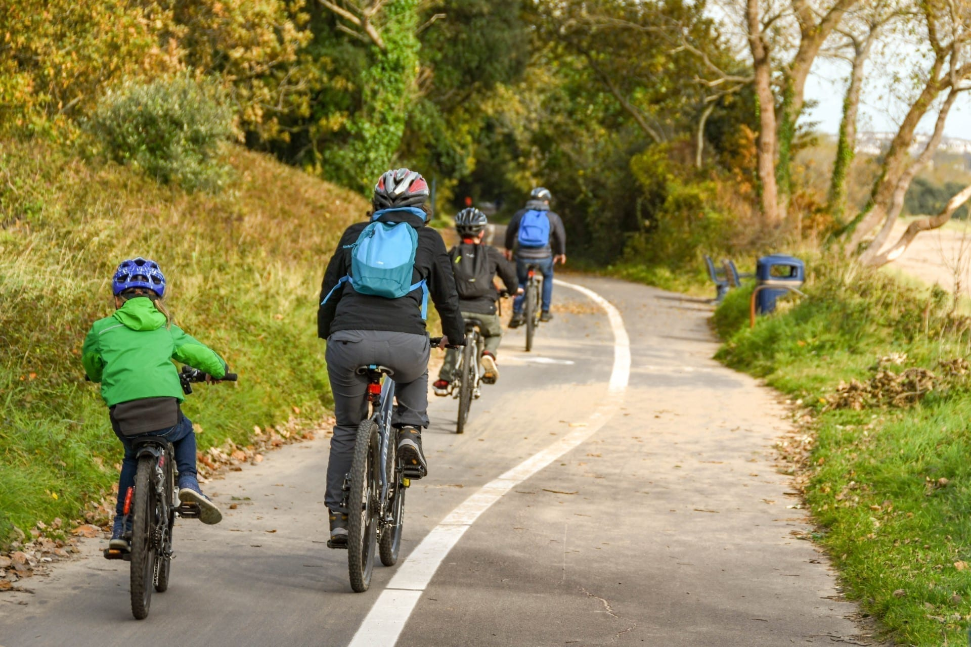 People cycling on the coastal path from Mumbles to Swansea