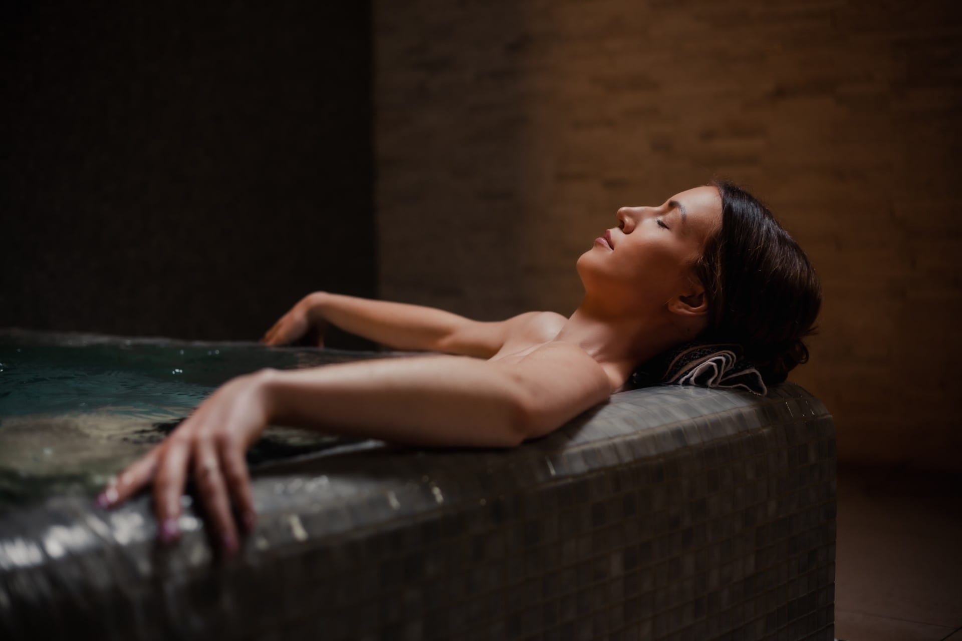 lady relaxing in a hot tub
