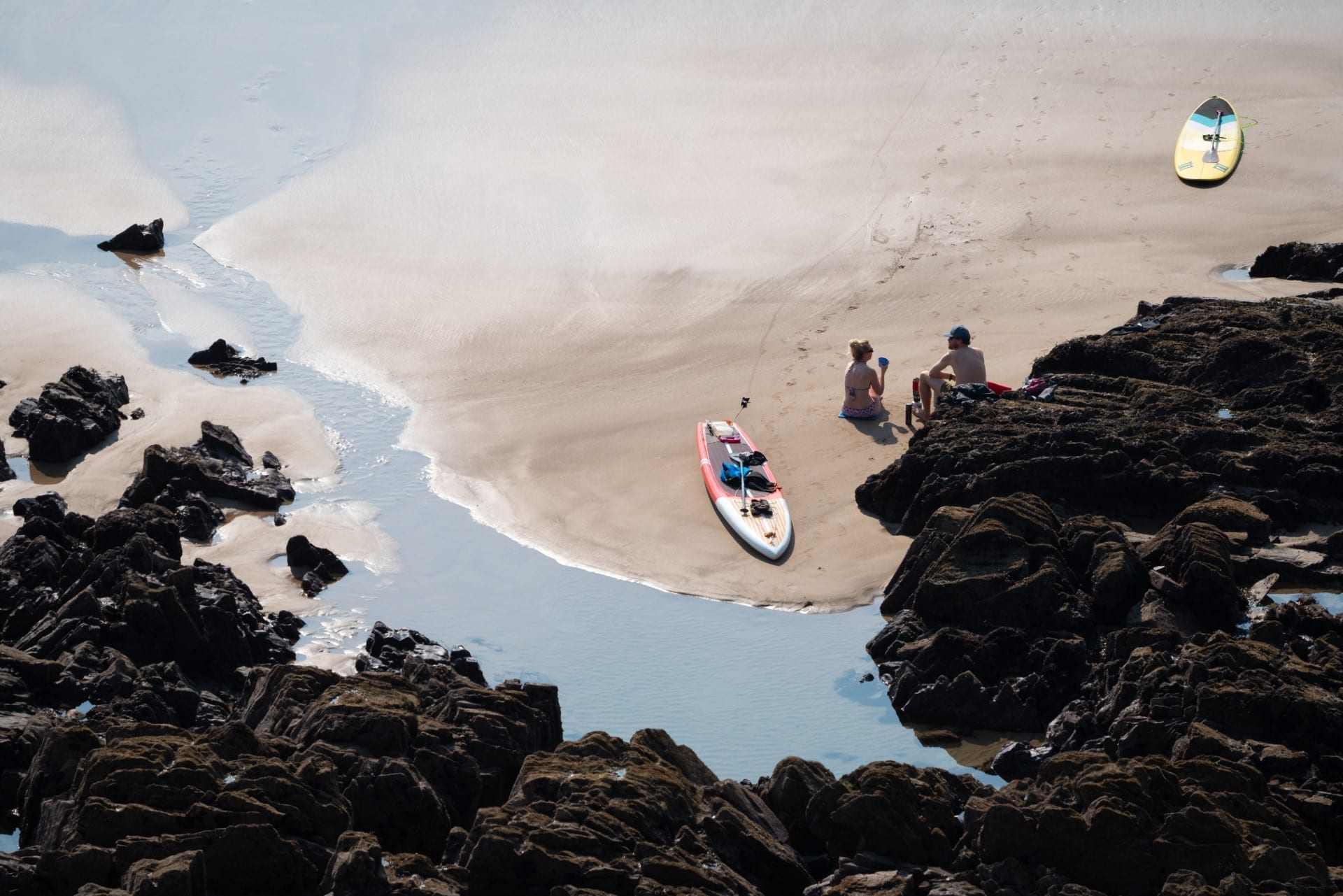 2 surfers on the beach at Poppit Sands, Cardigan