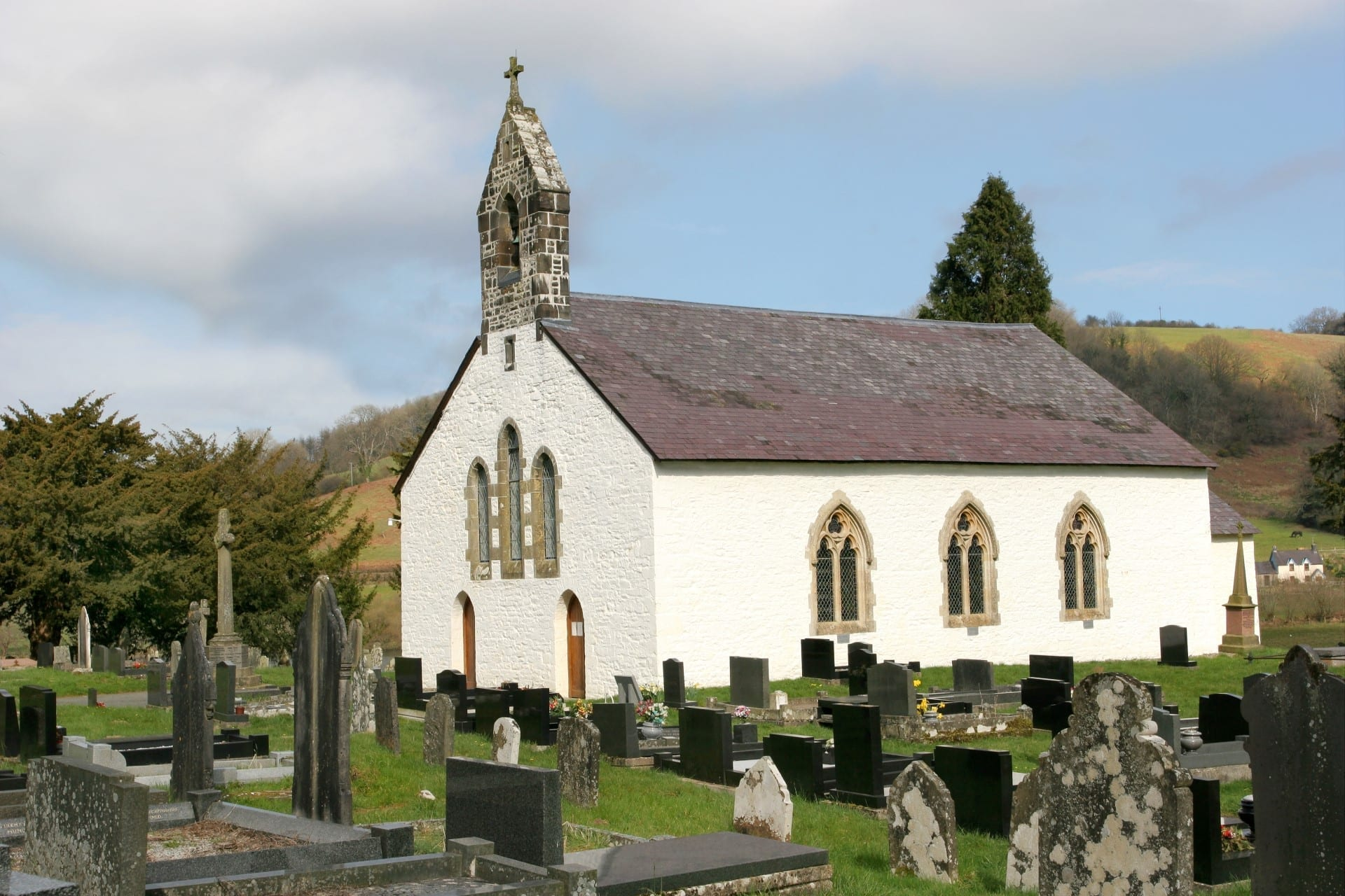 A chapel with the graveyard in the picture in wales